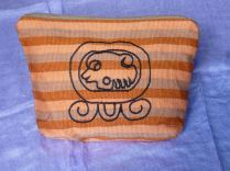 """3.F GLYPH TZ'I' From San Pedro la Laguna Sololá, Guatemala Made by women members of Grupo Ecológico Teixchel. Embroidered with Nawal glyph signs. $20.00 Sizing:6.5"""" H x 7.5"""" L Amount Available: 1"""