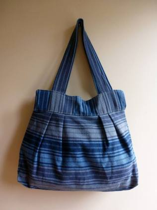 """$30.00 Measure: 10""""H x 15.5"""" W with a 22"""" Strap. With full zipper closure and an inside pocket. Hand washable. Amount available: 1 unit From San Juan la Laguna, Sololá. Woven by Tz'utujil-Maya women, of Asociación de Mujeres Tejedoras con Tinte Natural LEMAAutoayuda Chinamaya. Products are made with natural dyes with the women themselves staining the raw threads with colors extracted from carrots, allspice, fuchsia, annatto seed, avocado leaves, sacatinta, hilamo, guachipilin, and St. John's Wort among others."""