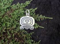 """Maya Nawal Glyph """" Iq' """" Pendant $30.00 Amount Available: 1 The glyph signifies a window which was used in the times of the classic Maya, by our ancestors, in which wind came through. This is a good day for renovation; to ask for the good winds to come and nourish our minds and to purify us."""
