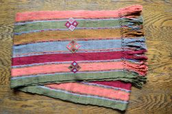 "2.1 $30.00 Measure: 10"" x 64"" (plus fringe) Hand washable. Amount available: 1 unit From San Gaspar Chajul, Quiché. Woven by Ixil-Maya women, of Asociación Chajulense."