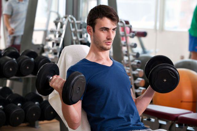 Male-Bicep-Curl-Lifting-Weights-Dumbbells-Gym