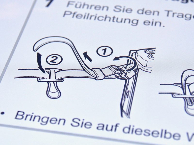 Olympus Anleitung Trageriemen | Foto: konsensor.de