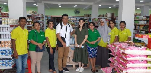 Take a picture with Mrs. Rita (Beta Mart Owner) and all staff