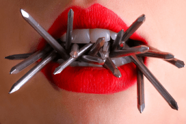 mouth with red lipstick with nails