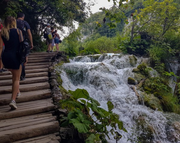 Bordwalk in Plitvice with small waterfalls and tufa formations together with moss and other organisms