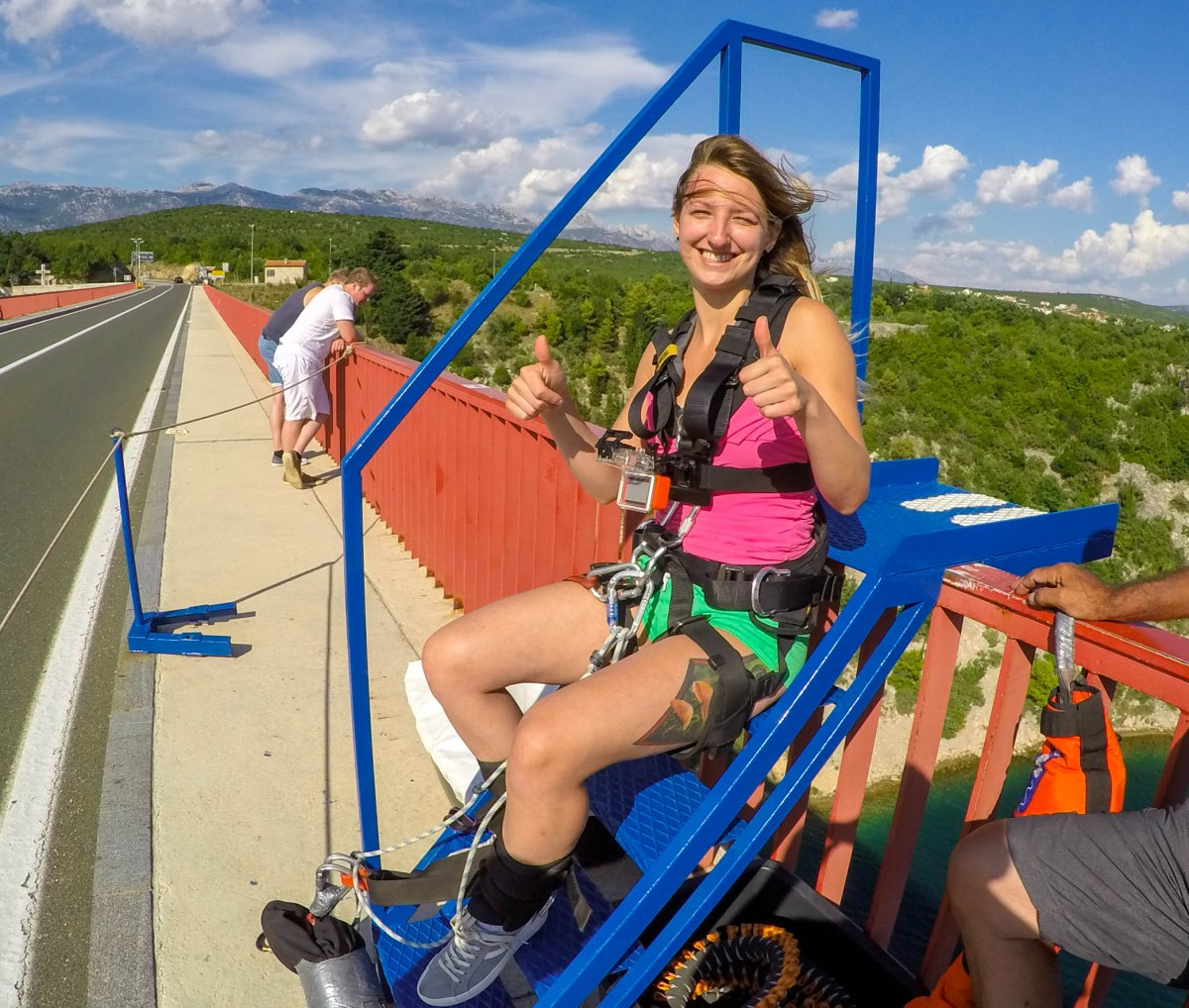 A girl preparing to bungee jump from Maslenica bridge in Croatia on a beautiful sunny day