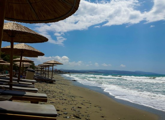 Sun umbrellas in Kokkinos Pirgos beach in Crete