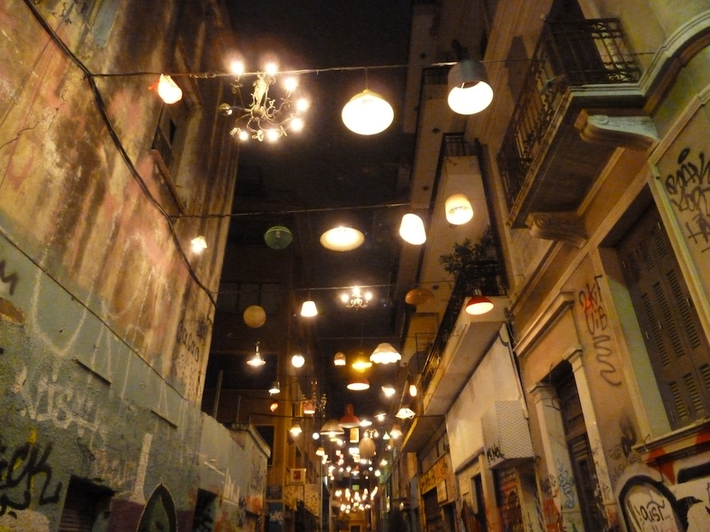 Athens: old lampshades suspended above the street, lighting what was once a dark urban street