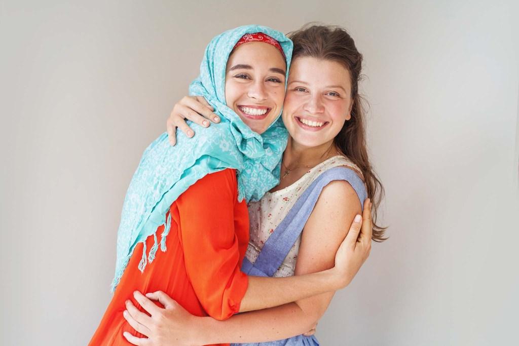 Two smiling women hugging