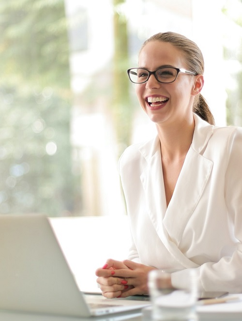 Smiling-Woman-using-PromoStandards