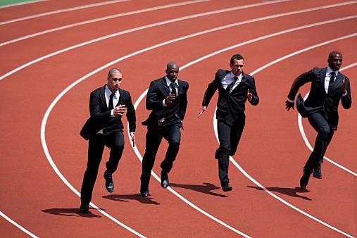 Businessmen runnin g on track