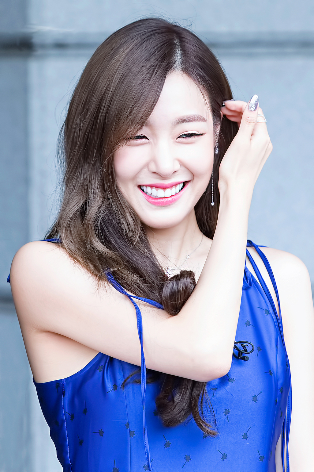 Tiffany smiling and brushing her hair