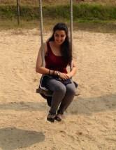 Ayesha on a swing.