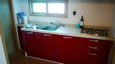 I actually really like that the cabinets are red!