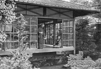 NAMIKAWA SAN FEEDING HIS CARP In lotus-land Japan, 1910 by H.G.Ponting