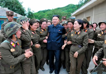 North Korean leader Kim Jong-un (C) visits the Thrice Three-Revolution Red Flag Kamnamu (persimmon tree) Company under the Korean People's Army Unit 4302 in this undated picture released by the North's official KCNA news agency in Pyongyang on August 24, 2012. KCNA did not state precisely when the picture was taken. Kim is seeking an ice-breaking trip to key ally Beijing next month to meet China's outgoing and new leaders, a source with ties to Pyongyang and Beijing told Reuters on Friday. REUTERS/KCNA (NORTH KOREA - Tags: POLITICS MILITARY) THIS IMAGE HAS BEEN SUPPLIED BY A THIRD PARTY. IT IS DISTRIBUTED, EXACTLY AS RECEIVED BY REUTERS, AS A SERVICE TO CLIENTS. NO THIRD PARTY SALES. NOT FOR USE BY REUTERS THIRD PARTY DISTRIBUTORS