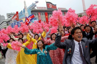 People react as they see North Korean leader Kim Jong Un during a mass rally and parade in the capital's main ceremonial square, a day after the ruling party wrapped up its first congress in 36 years by elevating him to party chairman, in Pyongyang, North Korea, May 10, 2016. (REUTERS/Damir Sagolj)