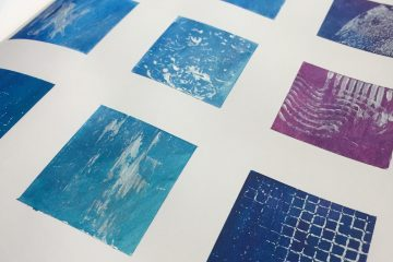 Small blue and purple colour swatches in a sketchbook by Kore Sage