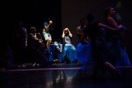 Dancers Simon Harrison and Radhanath Thialon perform surrounded by audience members.