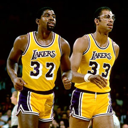 LOS ANGELES - 1987: Magic Johnson #32 and Kareem Abdul Jabbar #33 of the Los Angeles Lakers walk off the court during the NBA game against the New Jersey Nets at the Forum in Los Angeles, California. NOTE TO USER: User expressly acknowledges and agrees that, by downloading and or using this photograph, User is consenting to the terms and conditions of the Getty Images License Agreement. Mandatory Copyright Notice: Copyright 1987 NBAE (Photo by Andrew D. Bernstein/NBAE via Getty Images)