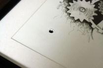 Loch durch Bilderrahmen