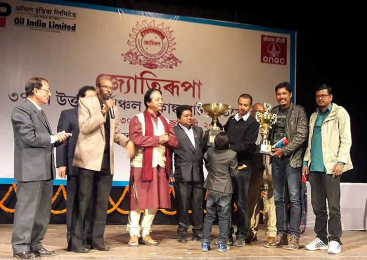The Best One-Act Drama Team award bagged by Natghar of Nityananda for the play _Murkhar Bakastu_