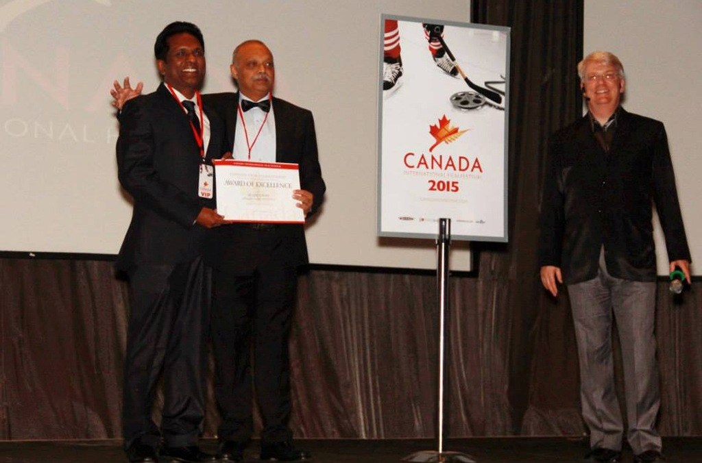 Ikramul Mazid(2nd from left) with Baharul Islam receiving the _Best Film_ award in the _Excellence in Cinema_ category at the Canada International Film Festival.