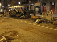 29/3/2012: Dumpster embers scattered across the street after general strike.
