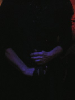 Woman stretching her scarf, while singing fados.