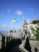 Part of Castelo dos Mouros (Castle of the Moors), along with their flags.