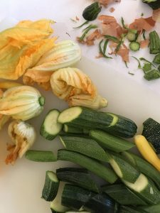 Baby courgettes and their flowers