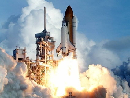 Space shuttle discovery on taking off from launch pad