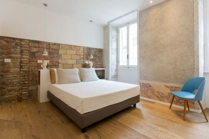 Via-Sistina-Apartment-bedroom-stone-wall
