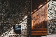 Rustic-house-gets-rehabilitated-in-Spain-stone-and-wood-on-facade