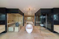 Villa-New-Water-by-Waterstudio.NL-bathroom-tub-at-center