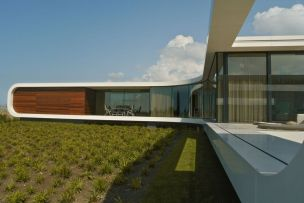 Villa-New-Water-by-Waterstudio.NL-glass-and-wood-facade