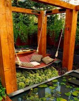 wooden-hammock-hanging-from-four-pillars-outdoor-reading-space-600x768