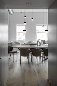 Numerous-pendants-do-a-great-job-filling-up-all-that-air-between-the-furnishings-and-a-high-ceiling-900x1362