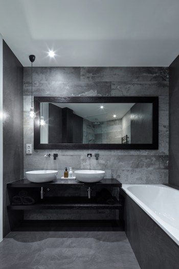 Prague-loft-apartment-withh-wide-framed-mirror-and-two-washbasins