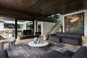 ARRCC-remodeled-residence-has-light-wooden-floors-that-contrast-with-the-dark-ceilings