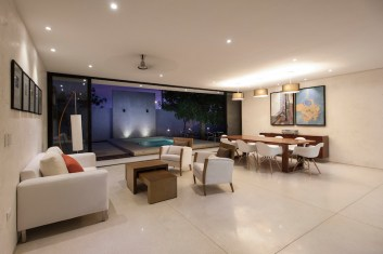 Merida-residence-features-an-open-plan-social-area-with-access-to-the-yard