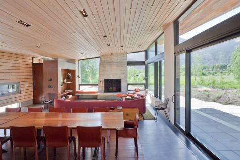 Mountain-facing-house-the-ceiling-is-covered-in-wood-the-same-as-the-floor