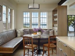 The-Book-House-features-a-cozy-nook-in-the-kitchen-framed-by-lake-views