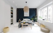 navy-feature-wall-border-lights-contrast-bedroom