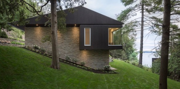 The-Slender-House-sits-on-a-slope-and-has-stone-walls