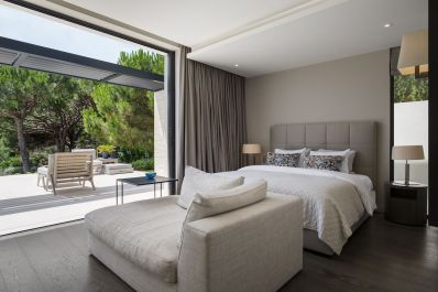 St-Tropez-Residence-has-a-bedroom-with-a-view-of-the-forest