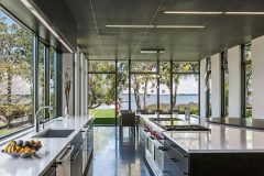 Lake-Waconia-House-features-a-huge-kitchen-with-large-windows