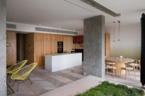 Ukraine-apartment-with-an-open-kitchen-dining-area-and-living-room-space