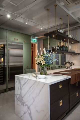 Beautiful-kitchen-with-gold-accents-and-marble-waterfall-countertop