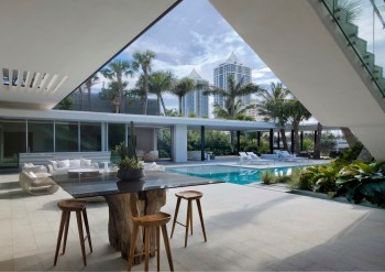 Pine-Tree-Miami-house-features-a-poolside-lounge-area